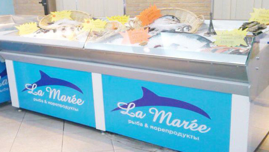 Refrigerated display case for seafood. Designed to showcase fresh fish and seafood.